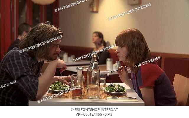 MS, Lockdown, Focus on Foreground, A man and a woman eating dinner in a cafe