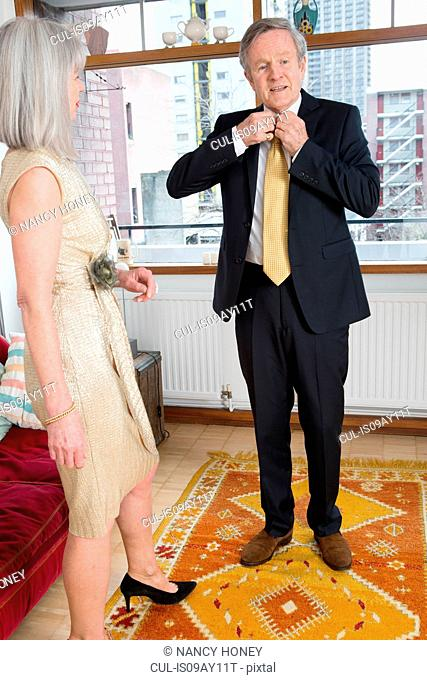 Couple dressing up getting ready at home