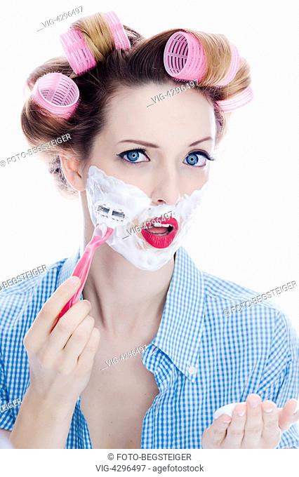 woman with hair roller shaving - , 11/03/2014