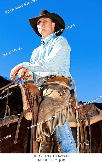 Low angle view of Caucasian rancher riding horse