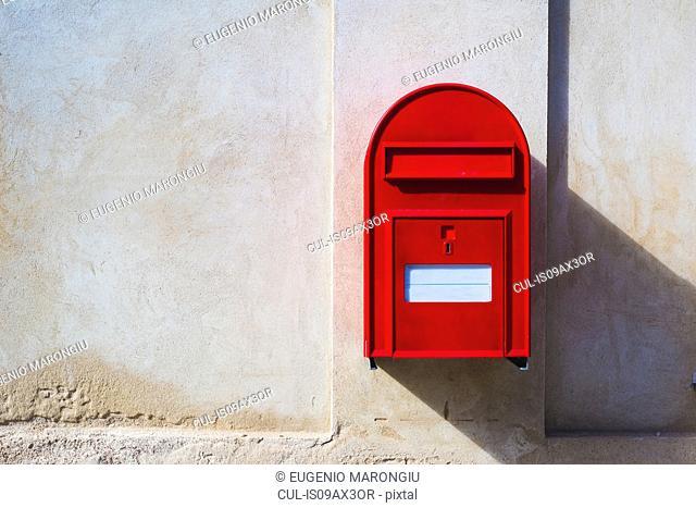 Red postbox on wall, Copenhagen, Denmark
