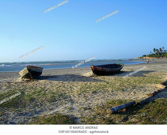 two boats canoes anchored at jericoacoara beach sands