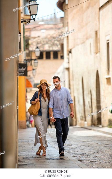 Couple walking on street, Palma de Mallorca, Spain