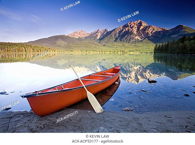 Red canoe on shore at Pyramid Lake, Jasper National Park, Alberta, Canada