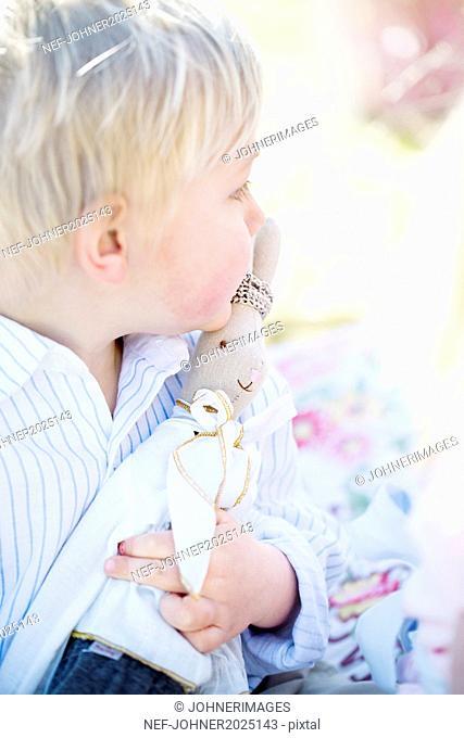 Boy with rabbit toy