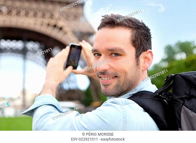 Young attractive tourist taking picture in Paris