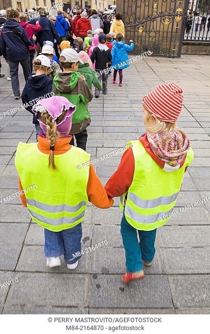 Two school children part of a group visiting the Prague Castle grounds, Prague, Czech Republic