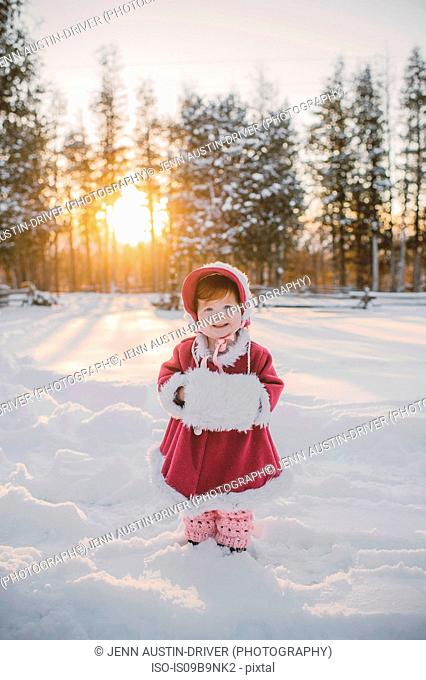 Portrait of young girl standing in snow
