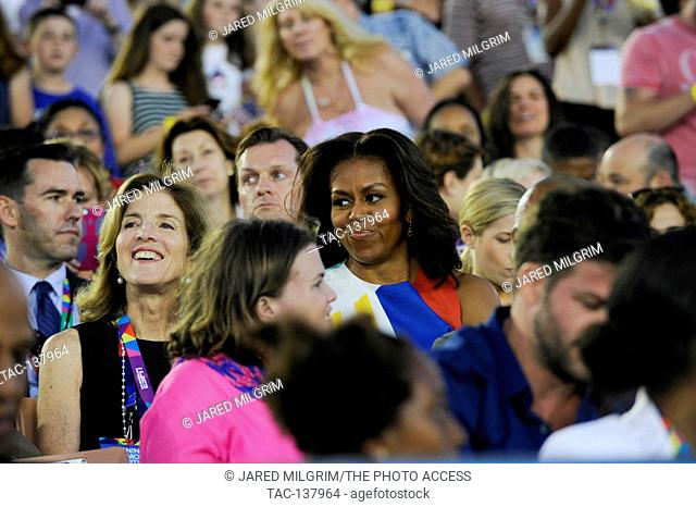 Author Caroline Kennedy and First Lady Michelle Obama sitting with the crowd at the Special Olympics World Games Opening Ceremony at the Coliseum on July 25th