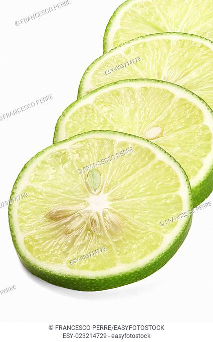 green fresh lime slices isolated over white background