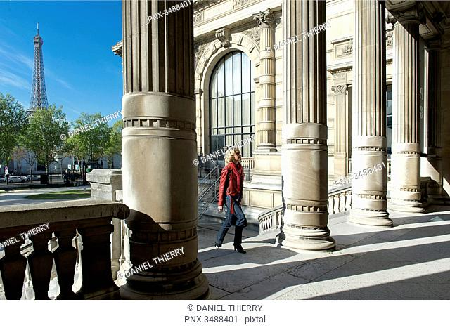 France. Paris 16th district. Parisian woman between the columns of the Galliera palace, the museum of the fashion of the City of Paris