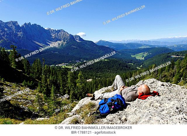 Hiker resting, Kaiserstein mountain, Rotwand mountain, Croda Rossa mountain, Rosengarten massif, UNESCO World Heritage natural site, Province of Bolzano-Bozen
