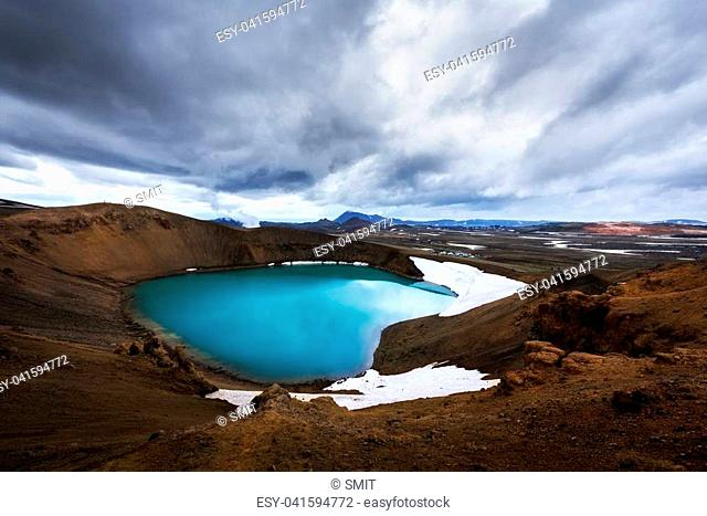 Acid hot lake in the geothermal valley Leirhnjukur, near Krafla volcano, Iceland, Europe