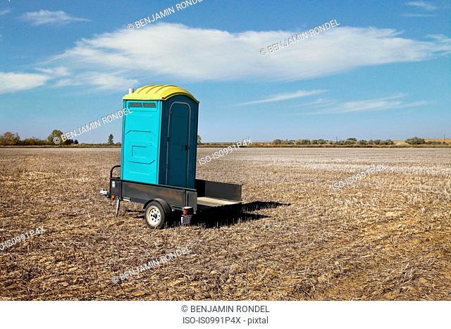 Portable toilet in field