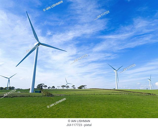 Group Of Turbines On Wind Farm In UK Countryside