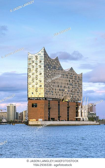 Germany, Hamburg, HafenCity. Elbphilharmonie (Elbe Philharmonic Hall) concert hall on the Elbe River at sunset