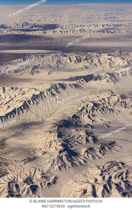 Flying aboard a Qatar Airways flight over snowcapped peaks near Isfehan, Iran