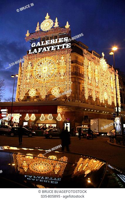 Night view of Galeries Lafayette with Christmas lights decoration, Paris. France