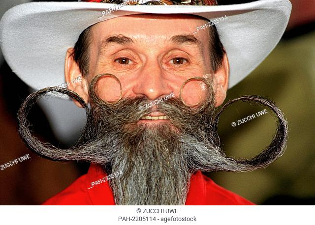 """""""""""""""""""""""Art on the beard"""""""": Ernst Krause sets himself on the 20th of March 1999 at the international German beard championship in Marburg in the category chin and..."""