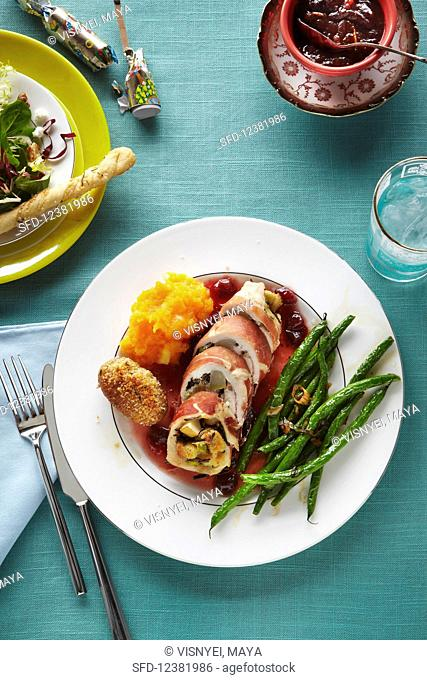 Stuffed pork roulade with green beans and cranberry sauce