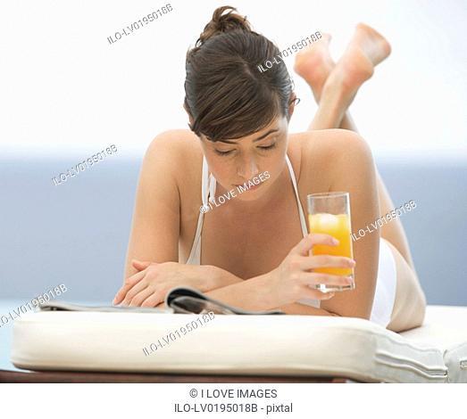 A woman relaxing on a sun lounger