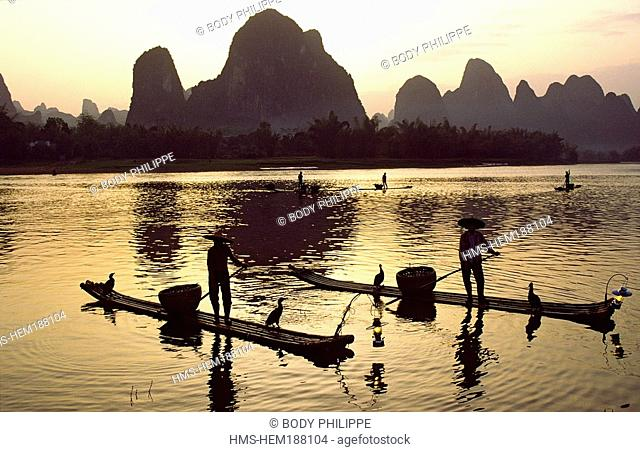 China, Guangxi Province, Guilin, Li River, cormorants are tamed for fishing on a boat in bamboo