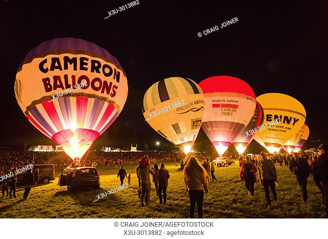 Bristol UK - hot air balloons taking part in the night glow at the 39th Bristol Balloon Fiesta Thursday 10th August 2017 at Ashton Court