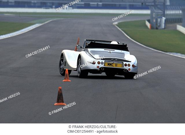 Car, Morgan Aero 8, Convertible, model year 2000, silver, driving, test track, diagonal from the back, rear view, open top