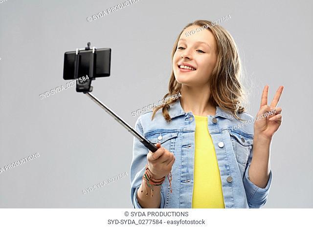 teenage girl taking selfie by smartphone