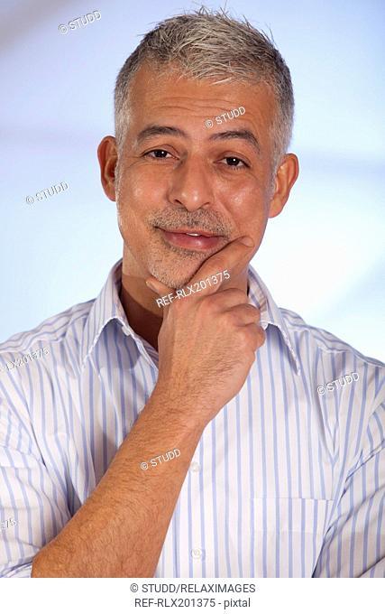Portrait smiling businessman thinking old senior