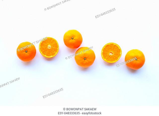 Fresh orange citrus fruit on white background