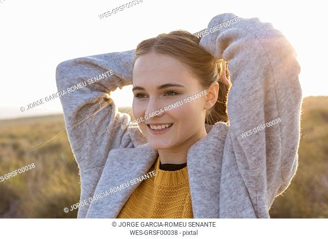 Portrait of smiling young woman at sunset