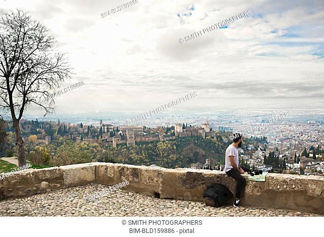 Man admiring scenic view of cityscape, Granada, Spain