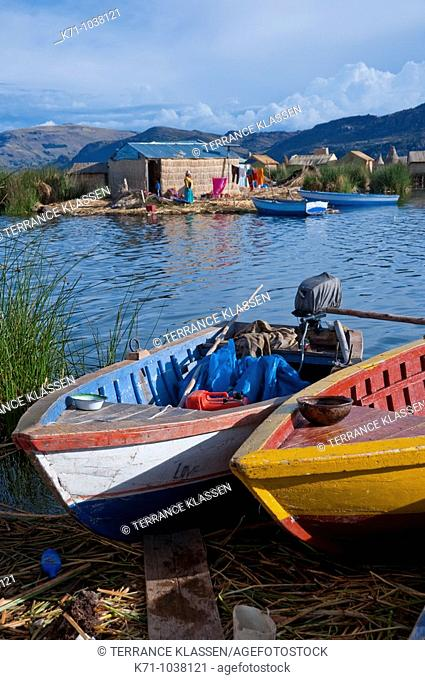 Boats on the shore at the floating Islands in Lake Titicaca, Peru, South America