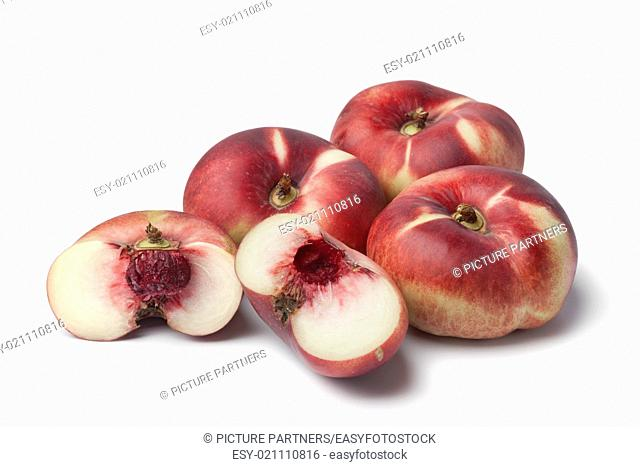 Fresh ripe wild nectarines on white background