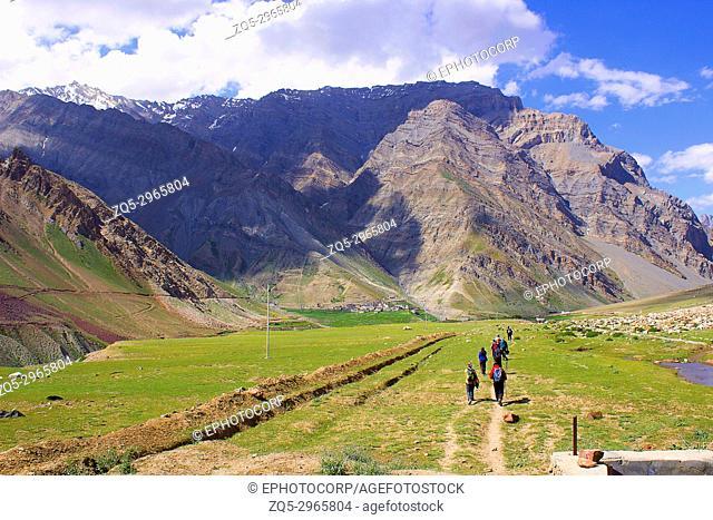 Perspective view of trekkers walking towards the next mountain. Himachal Pradesh, Northern India