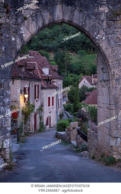 Pre-dawn at the old entry gate to medieval town of Saint-Cirq-Lapopie, Midi-Pyrenees, France
