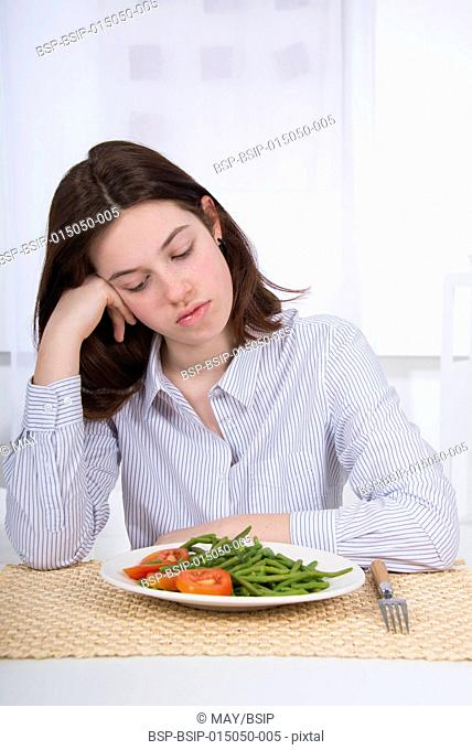Teenager with a plate of vegetables