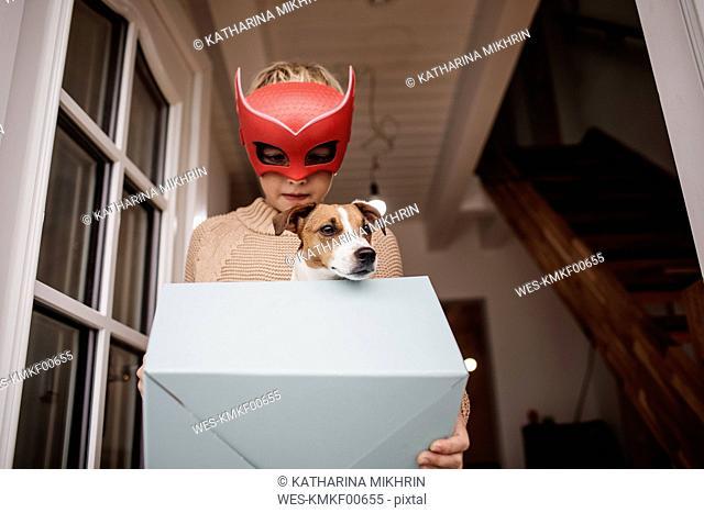 Boy wearing Superhero mask with Jack Russel Terrier in