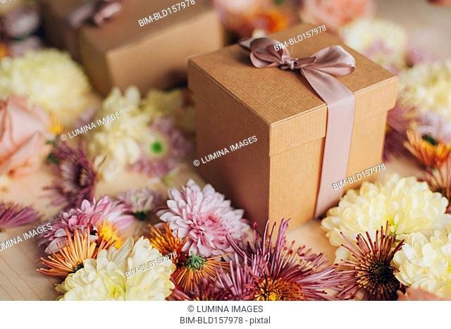 Close up of wrapped gifts and flowers