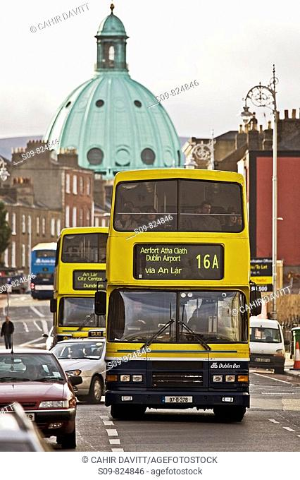 Dublin bus public transport in Dublin, Ireland, with Rathmines church dome in the distance