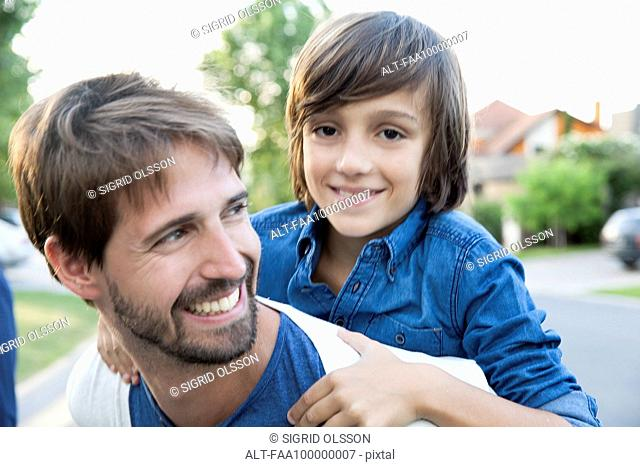 Father and son together outdoors, portrait