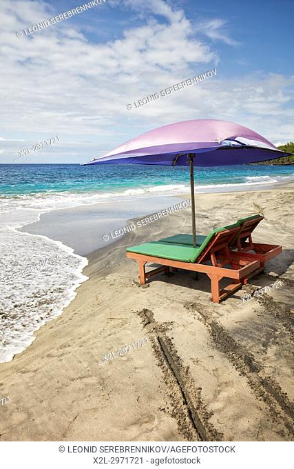 Sun beds and umbrella for rent on White Sand Beach (Pantai Bias Putih). Manggis subdistrict, Karangasem Regency, Bali, Indonesia