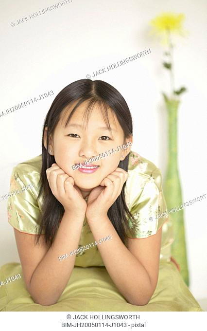 Girl resting her chin on her hands