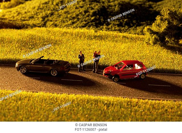 Diorama of a toy car crash
