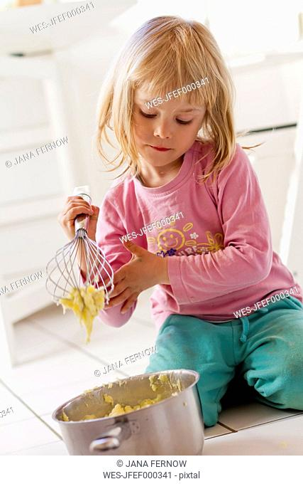 Little girl preparing mashed potatoes
