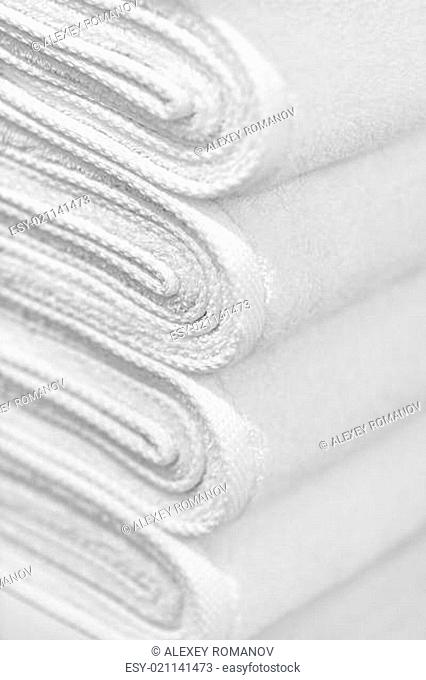 Stack of new white towels close-up - background