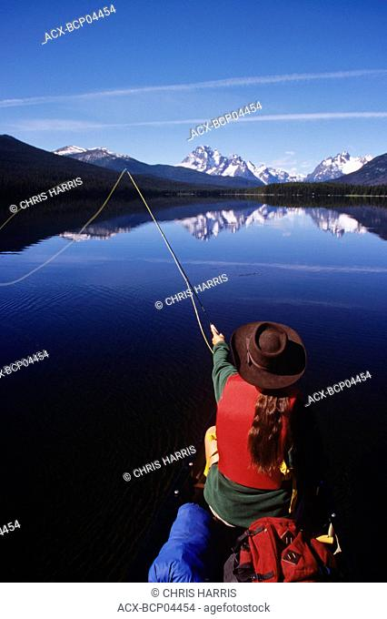 Fishing from canoe on Turner Lakes, Tweedsmuir Park, Chilcotin region, British Columbia, Canada