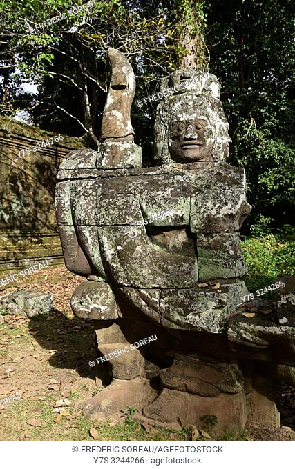 Guardian at Victory gate bridge of Angkor Thom, Siem Reap, Cambodia, South east Asia