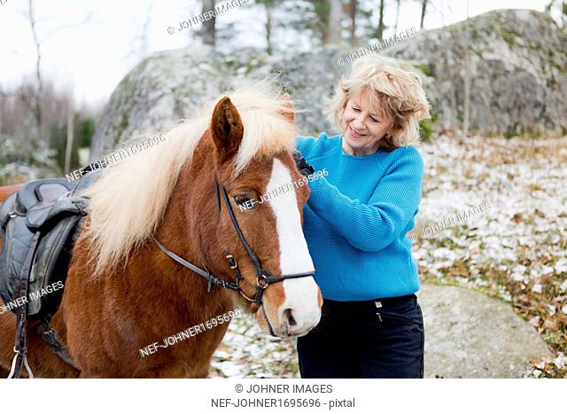 Senior woman with Icelandic horse